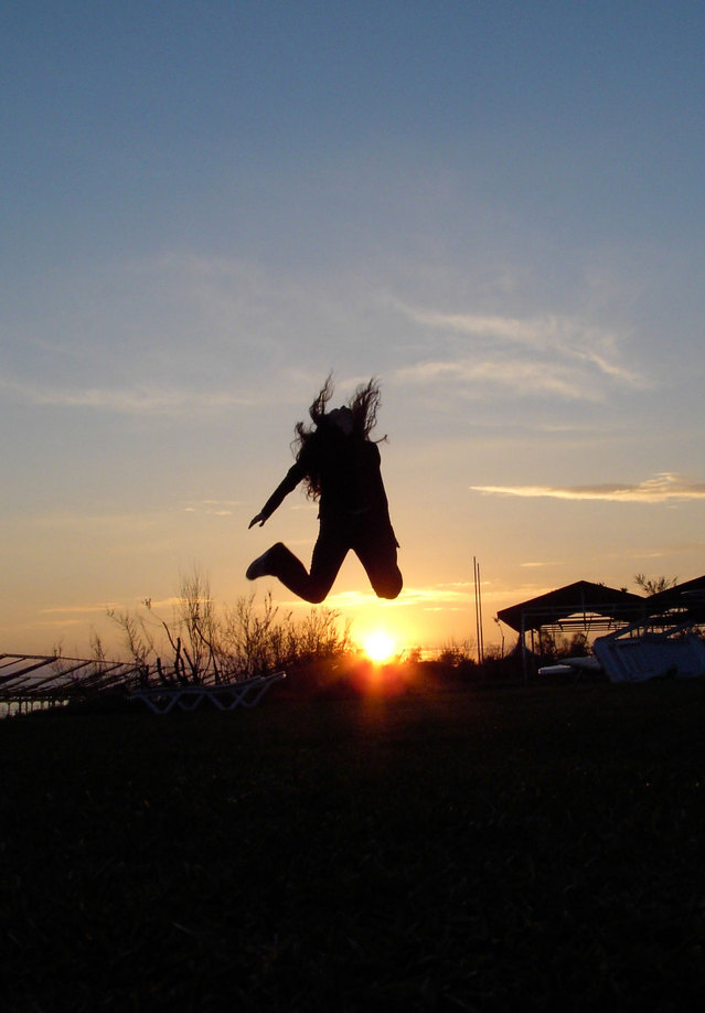 a silhouette oif a hapopoy person jumping in the air