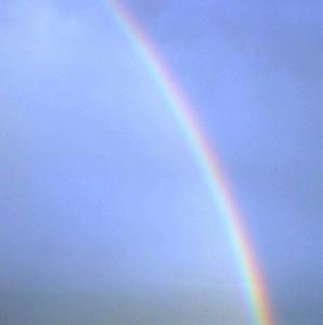 a segment of rainbow against a blue sky