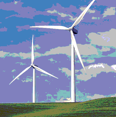 wind turbines against a green landscape