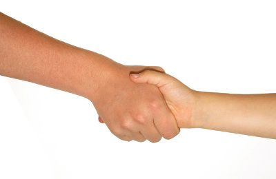 A handshake against a white background