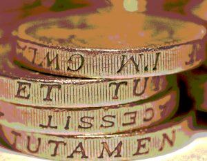Four £1 coins in a heap